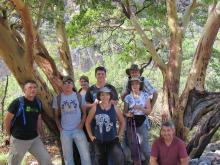 Group photo under large Madrone